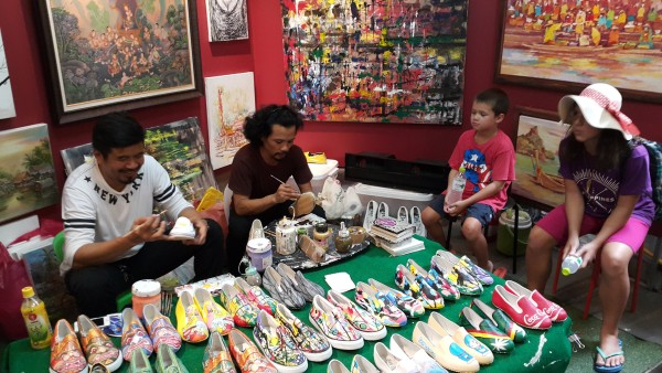 """Matt bought our """"Thailand painting"""" from these guys on a previous trip. Besides painting canvas art, they also paint shoes."""