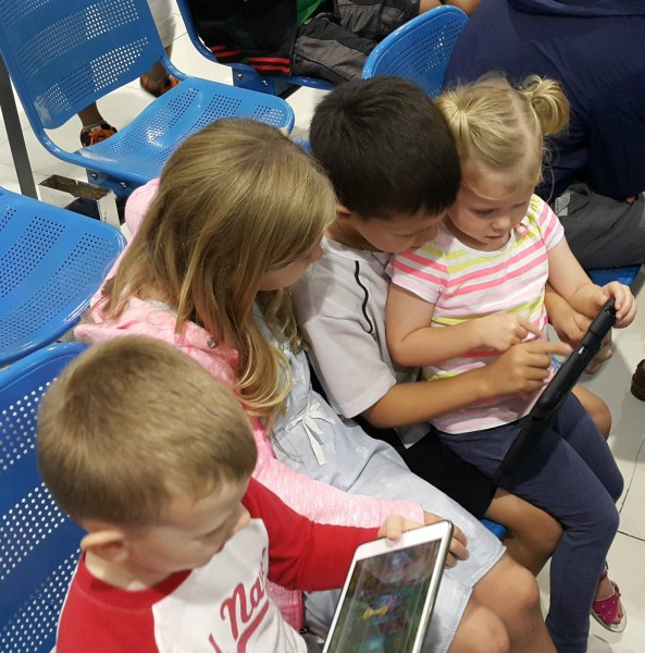 Our flight was delayed in Manila, so to pass the time the kids shared the iPads.