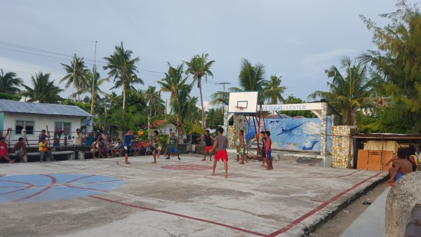 Even on a small island in the Philippines, basketball games are still played.
