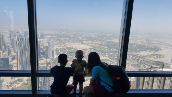 Our kids looking out at Dubai from the Burj Kalifa