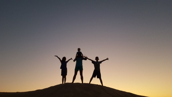 """After dinner we drove about 15-20 minutes and pulled off on the side of the road and picked a """"camp ground"""" area in the sand dunes. We got to watch the sunset with friends."""