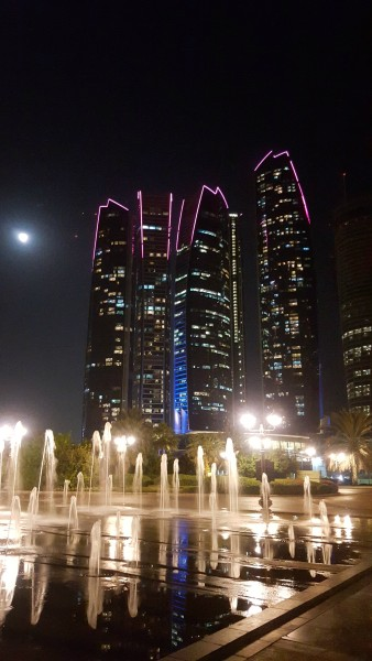 Night view of Etihad Towers that are across from Emirates Palace. The towers were used as a filming location for the 2015 film Furious 7. In the film, Dominic Toretto (Vin Diesel) and Brian O'Conner (Paul Walker) steal a Lykan HyperSport and drive it through three of the towers