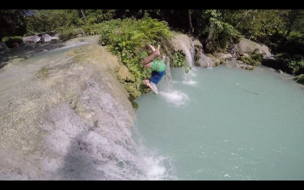 SIx year old Mason doing a flip off a rock at Cambugahay Falls